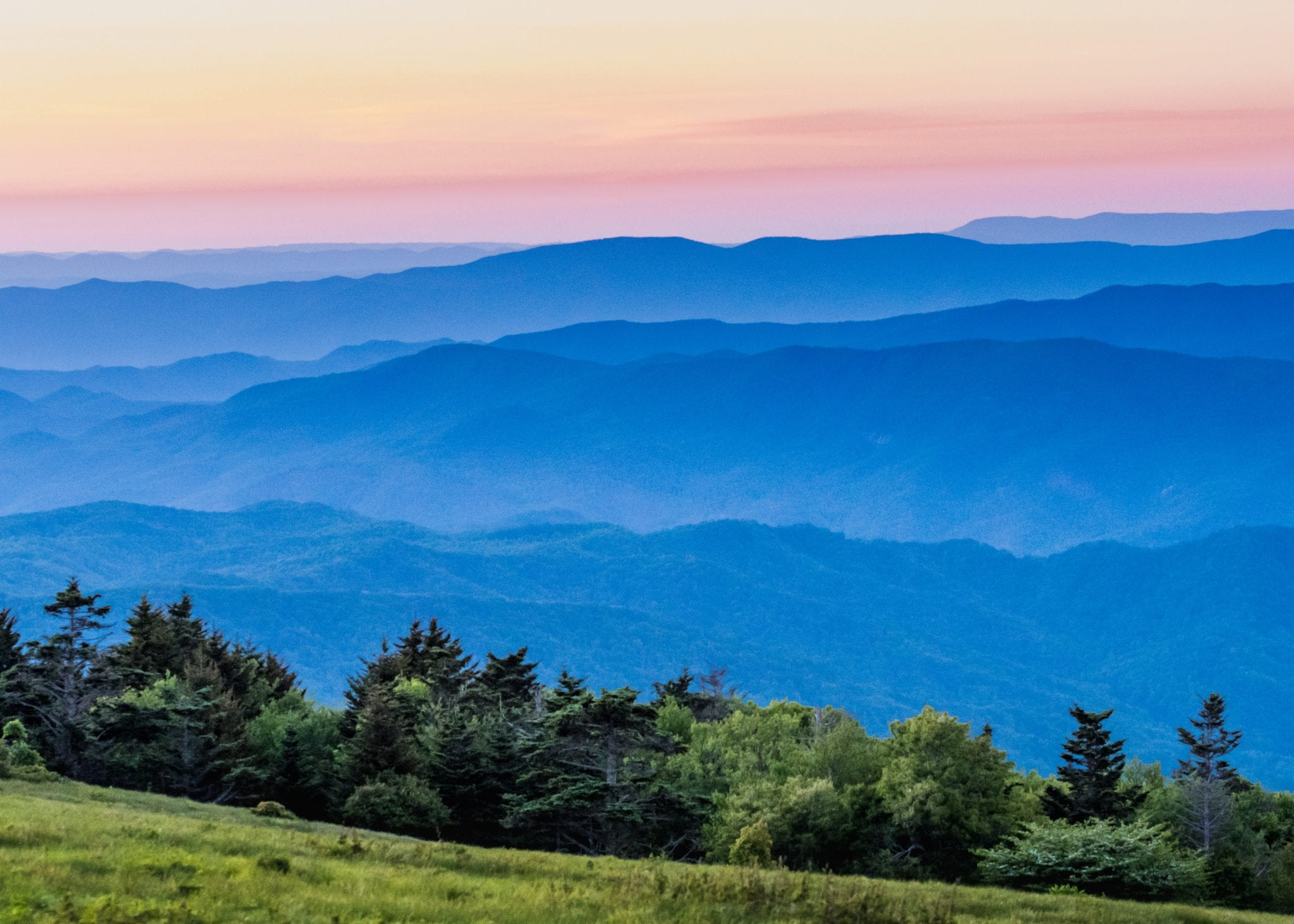 Hazy Blue Ridge Mountains at Sunset with grass bald in foreground
